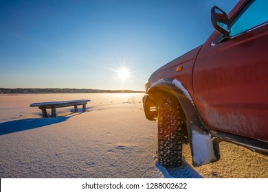 Four-wheel drive car front corner in Finland. The front sunlight shines brightly. There is winter and lots of snow.