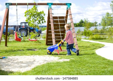four-year-old boy playing at a playground with sand outdoor