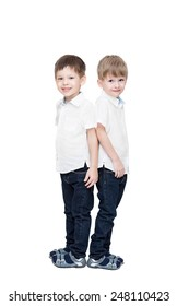 Four-year-old twins boys, in white linen shirts and jeans, to the utmost, isolated on the white