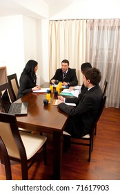 Fout business people having conversation at meeting table