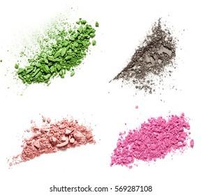 Fout shades of make up crushed eyeshadow on white background. Texture of crushed powder isolated on white