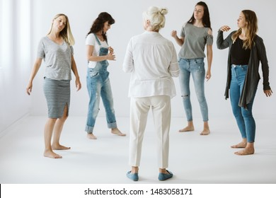 Fout teeage girls on a group therapy exercising their imagination
