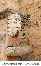 Foutain with lion head on a stone stairs outside Cathedral of Palma de Mallorca