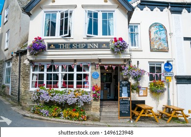 FOWEY, ENGLAND - JULY 3, 2019: Beautiful exterior of The Ship Inn, a typical English pub in Cornwall, UK. Built by adventurer John Rashleigh in 1570, The Ship Inn is Fowey's oldest pub.