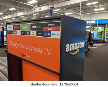 Fox Hills, Culver City, California -  October 25, 2018:    Amazon Fire TV and App logos Netflix, Hulu, HBONow, ESPN, ABC, NBC, Vevo, Showtime on pop-up display in California Best Buy store.