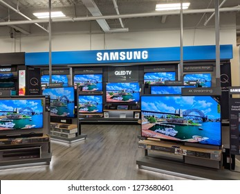 Fox Hills, Culver City, California -  October 25, 2018:  Samsung Logo and QLED TV inside Best Buy Store.  Samsung is a South Korean multinational conglomerate headquartered in Samsung Town, Seoul.
