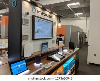 Fox Hills, Culver City, California -  October 25, 2018:  Alexa Amazon display featuring Echo, Dots, Cameras and smart lights  in California Best Buy store. Amazon's virtual assistant Alexa.