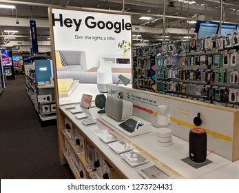 Fox Hills, Culver City, California -  October 25, 2018:  'Hey Google' Google Home Hub Logo on Display featuring google products inside of Best Buy Store.