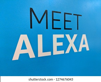 Fox Hills, Culver City, California -  October 25, 2018:  Meet Alexa Amazon Echo sign which is a Smart Assistant on a blue wall display in California Best Buy store. Amazon's virtual assistant Alexa.