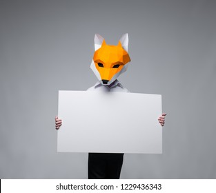 Fox holds white sign