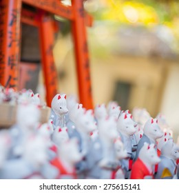 Fox statues at Fushimi Inari Shrine in Kyoto, Japan