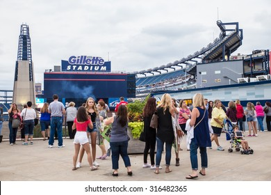 FOXBORO, MASSACHUSETTS - SEPTEMBER 12, 2015:  Fans await entry into Gillette Stadium, home of the New England Patriots,  for the One Direction concert.