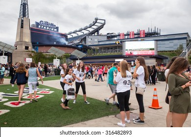 FOXBORO, MASSACHUSETTS - SEPTEMBER 12, 2015:  Fans taking photographs as they await entry into Gillette Stadium, home of the New England Patriots,  for the One Direction concert.