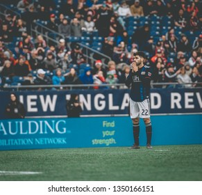 FOXBOROUGH, MASSACHUSETTS - MARCH 24, 2019: New England Revolution designated player, Carles Gil, reacts to his shot during the MLS match against FC Cincinnati in the Gillette Stadium.