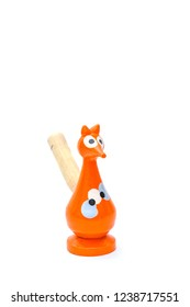 Fox-shaped baby whistle - isolated on white background. Children's toy, a musical instrument.