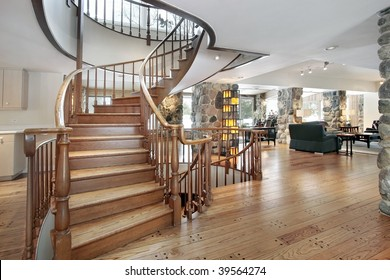 Beau Foyer With Curved Staircase
