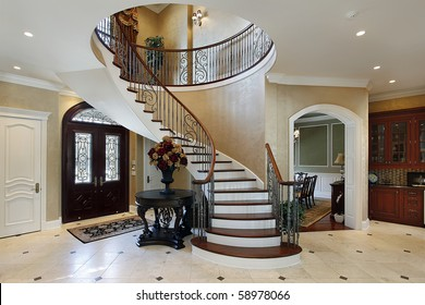 Foyer in luxury home with circular staircase