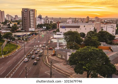 Foz do Iguacu, Brazil - January 06, 2018: Panoramic view from the city of Foz do Iguacu, the Costa e Silva avenue, cars on the street during a sunset. Touristic city bordering Paraguay and Argentina.