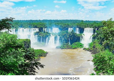 Foz do Iguacu, Brazil - January 07, 2018: Waterfalls from Cataratas do Iguacu, Brazil. Brazilian side of the waterfalls. Many big waterfalls on the Iguacu river surrounded by nature.