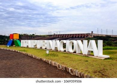 Foz do Iguacu, Brazil - May 05, 2014: Big logo of Itaipu Dam Consortium, in touristic location with a view of the Itaipu dam.