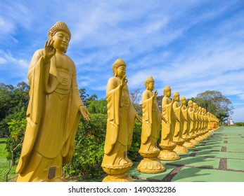 Foz do Iguacu/Parana/Brazil. May, 2018. Chen Tien Buddhist Temple. View of statues of a reincarnation of Buddha in Chen Tien Buddhist Temple. Golden statues in a row. Buddhist symbols.