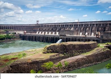 FOZ DO IGUASSU, PARANA - BRAZIL - NOVEMBER 26, 2013: Itaipu Dam saw from the Main Observation Deck - Lighting of The Dam. The dam is a binational undertaking run by Brazil and Paraguay.