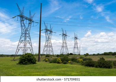 FOZ DO IGUASSU, PARANA / BRAZIL - NOVEMBER 26, 2013: A row of typical transmission line tower structures of Itaipu Dam Complex. The dam is a undertaking run by Brazil and Paraguay.