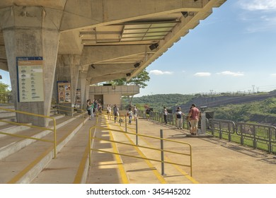 FOZ DO IGUAZU, BRAZIL, APRIL - 2015 - Group of tourist crossing the installations of the Itaipu dam in the brazilian border.