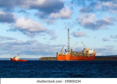 FPSO oil production vessel and supply ship.