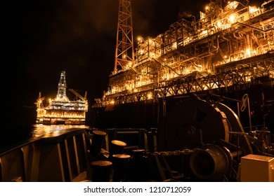 FPSO tanker vessel near Oil platform Rig. Offshore oil and gas industry, sea oil production and storage.