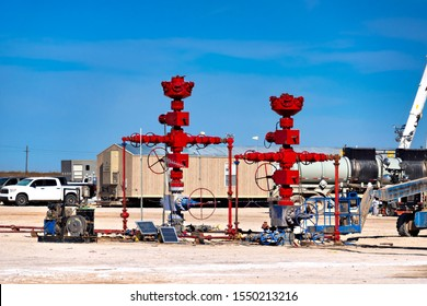 Fracking well and oil pipe line valves in oil field.