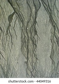 fractal pattern left in beach sand by retreating water, background