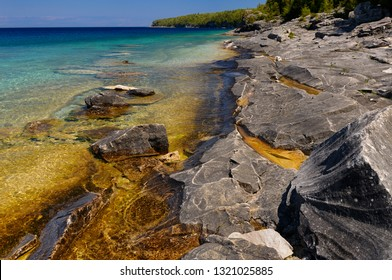Fractured limestone shore of Little Cove Bruce Peninsula Ontario in full sun