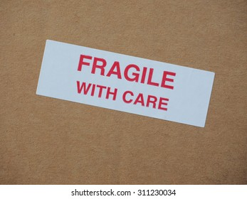 Fragile with care warning sign label tag on a cardboard box packet