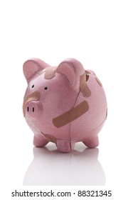 Fragile economy, broken piggy bank isolated ion white with copy space
