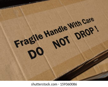 Fragile Handle with Care Do not drop label on a corrugated cardboard box