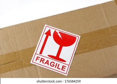 Fragile label on top of cardboard box