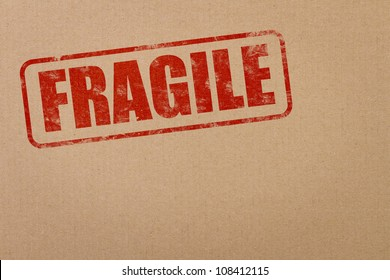 Fragile stamp on a cardboard package with copy space