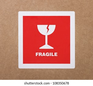 Fragile sticker at the cardboard package
