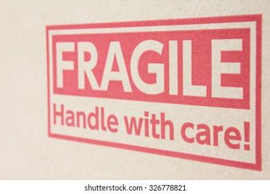 Fragile symbol on brown paper box