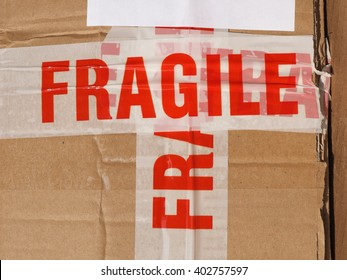 Fragile warning sign label tag on a cardboard box