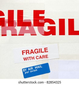 Fragile warning sign label tag on a cardboard box packet parcel for mail post shipping