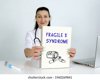 FRAGILE X SYNDROME text in menu. Hematologist looking for something at laptop