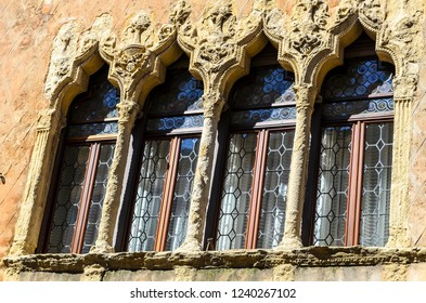 Fragment of the 15th century facade of Olzignanìs House (Casa Olzignani) windows framed with columns and arches typical of Italian medieval architecture.Padua. Italy