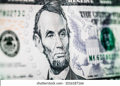fragment of 5 dollar bill