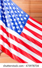 a fragment of the American flag on wooden background brown wall