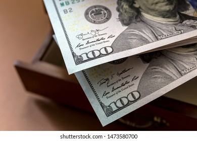 A fragment of American hundred-dollar bills close-up on a blurred background. Cash Money.