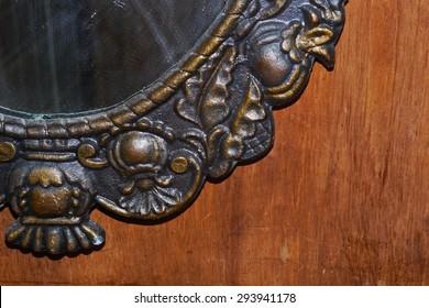 A fragment of an ancient bronze mirror