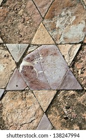 Fragment of an ancient  floor mosaic. Colorful stones of different forms, geometric ornament with Stars of David. Courtyard  of St.Euthymius Monastery. Israel