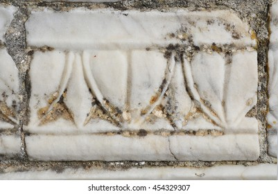A fragment of an ancient marble frieze.